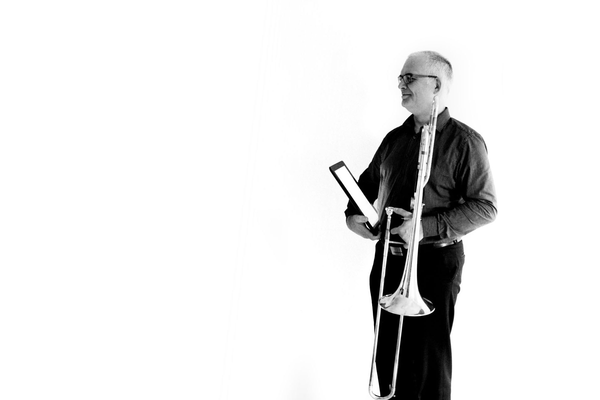 Jan Rosseel, founder of Scora with tablet and trombone